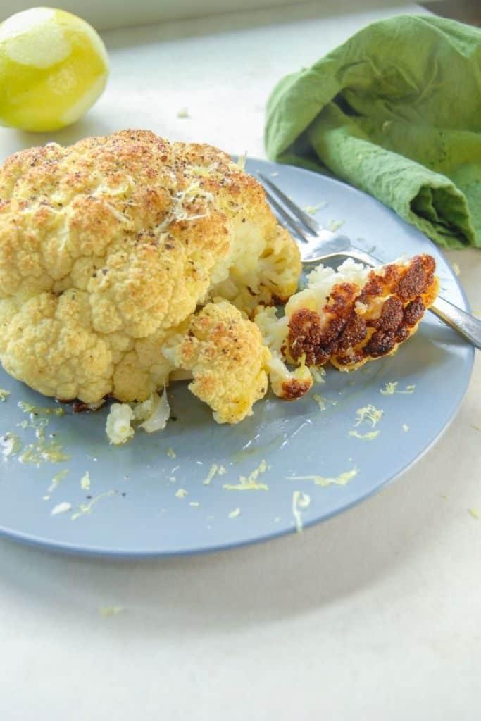 Bite of crispy caramelized whole roasted cauliflower.