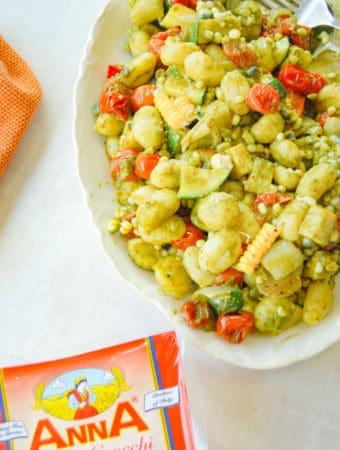 gnocchi succotash with vegetables on a platter