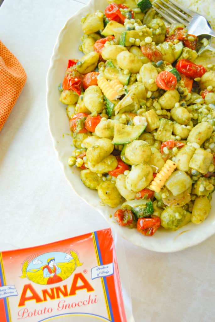 Anna potato gnocchi next to a platter of gnocchi succotash