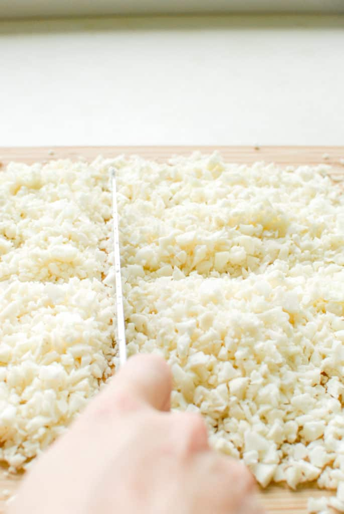 making cauliflower rice without a food processor, chopping cauliflower with a knife instead.