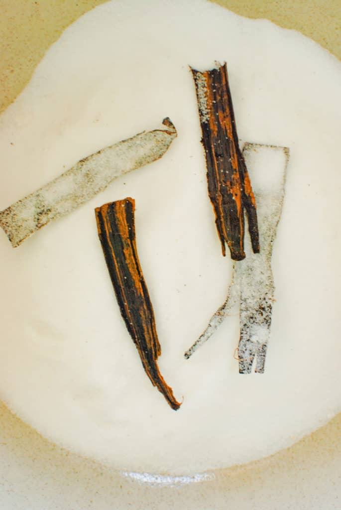 A bowl with vanilla bean pods in sugar, to make vanilla sugar