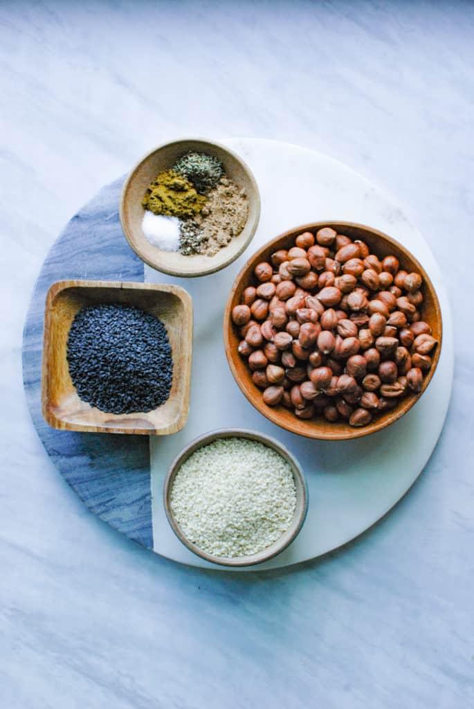 ingredients to make dukkah arranged on a countertop