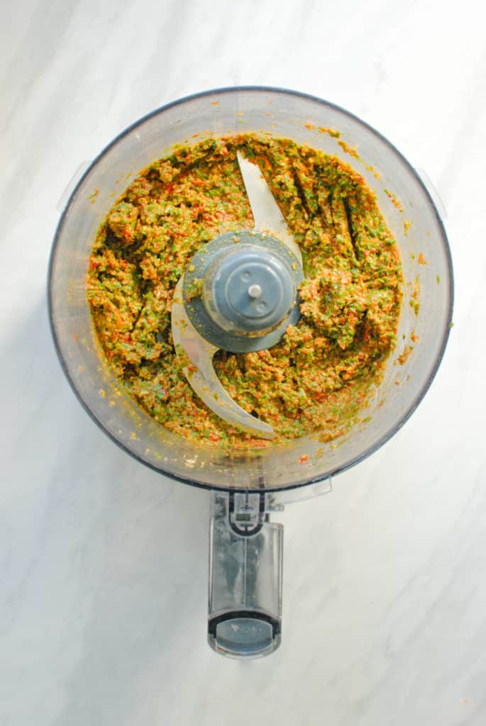 food processor with fresh vegan sundried tomato pesto sauce