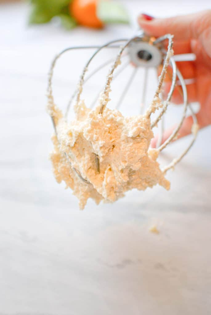 Butter and sugar on a mixing whisk after creaming.