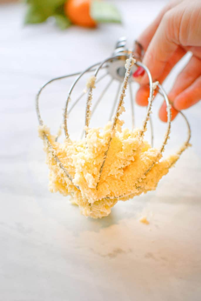 Butter and sugar on a mixing whisk before creaming.