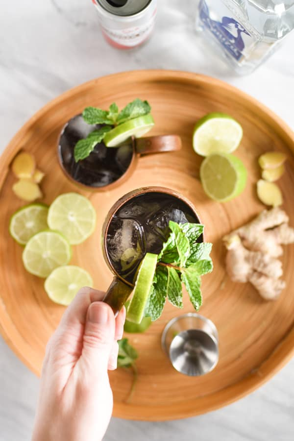 hand with Ingredients to make a mexican mule