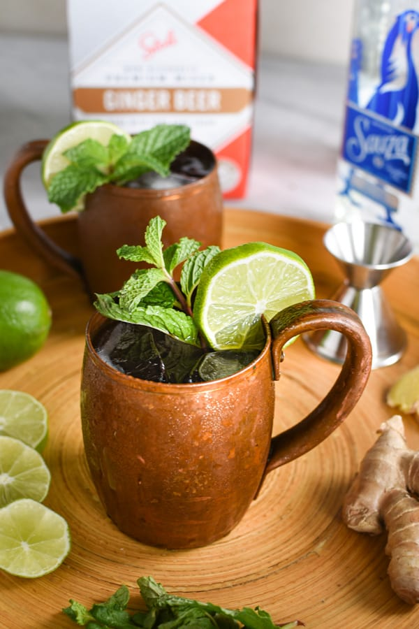 two tequila mules on a serving tray
