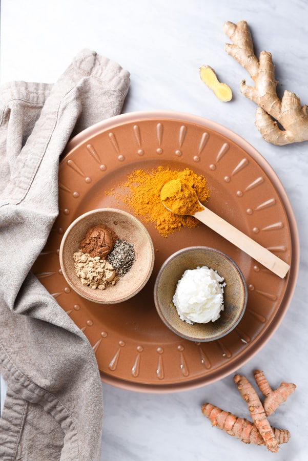 ingredients for turmeric paste on a plate