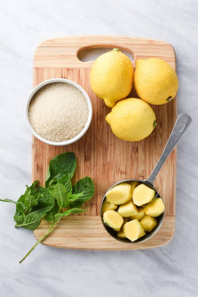 ingredients to make ginger juice on a cutting board