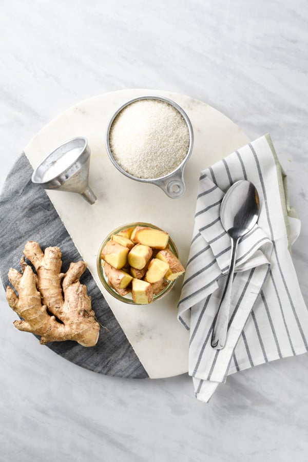 Ingredients for ginger syrup on a cutting board