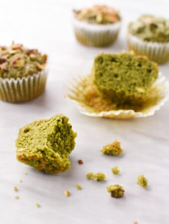 a green pistachio muffin cut in half