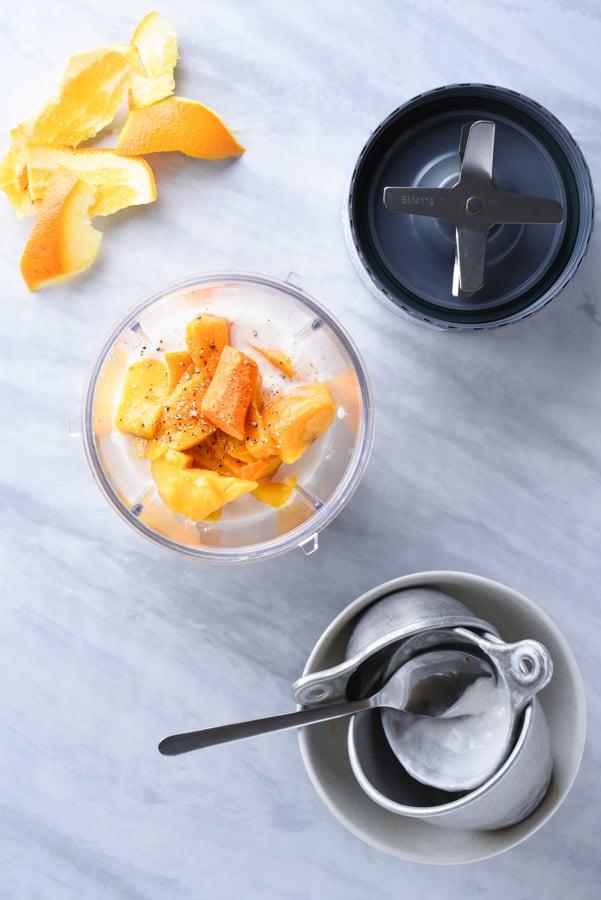 fresh turmeric, mango, and yogurt in a nutribullet