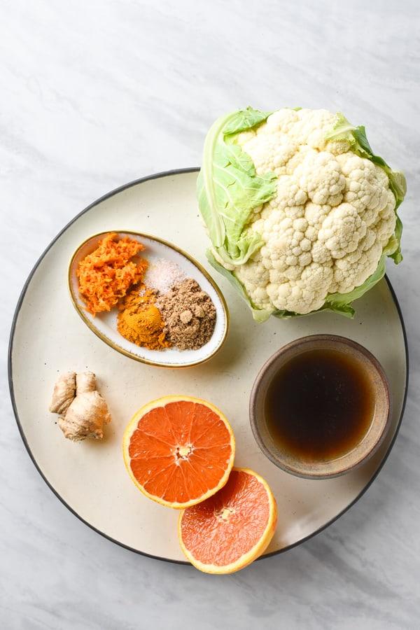 Ingredients to make vegan orange sauce on a plate