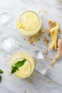 Overhead shot of 2 glasses of ginger juice