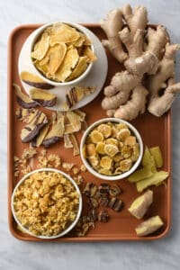 3 types of candied/crystallized ginger shown in 3 different bowls: slices, coins, and diced.