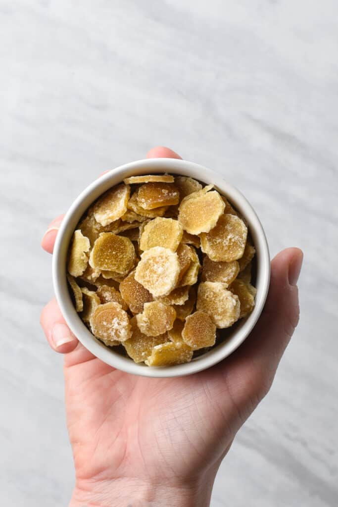 A bowl of candied ginger coins