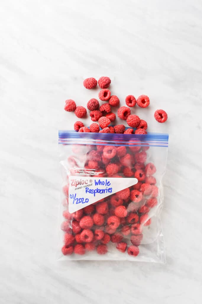 A plastic bag with frozen raspberries inside
