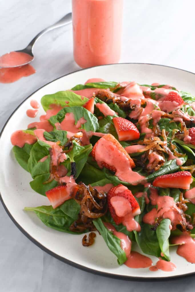 Strawberry vinaigrette on a spinach salad.