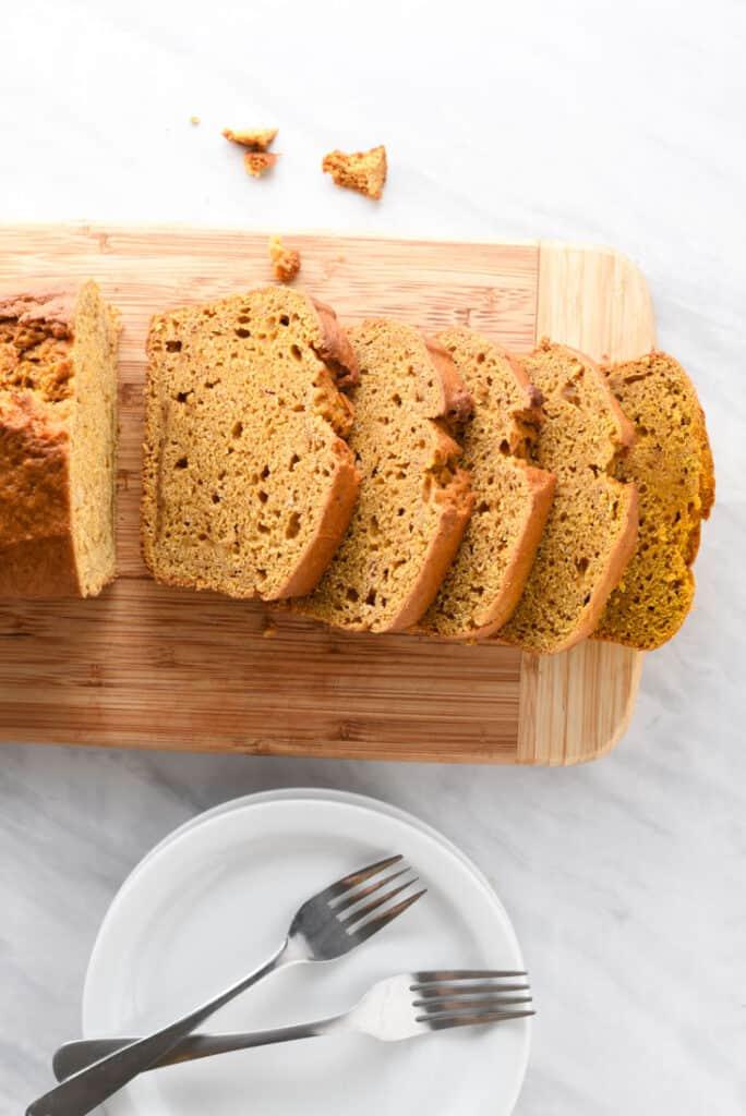 a loaf of vegan pumpkin bread cut into slices