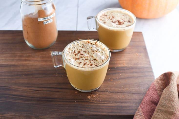 Vegan pumpkin spice latte on a cutting board