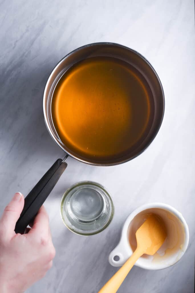 Honey and water in a small pot.